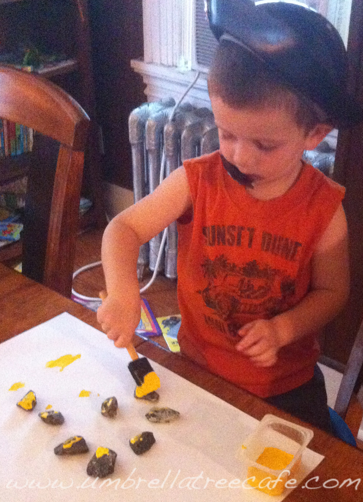 Painting rocks from the driveway to look like treasure
