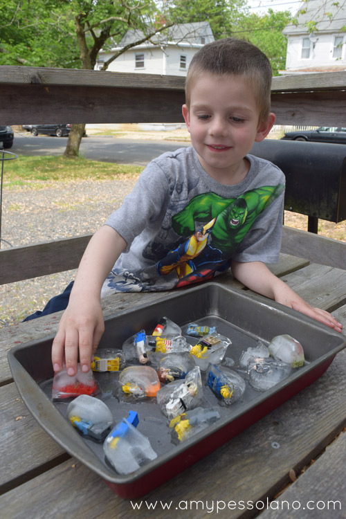 Figuring out how to rescue the lego minifigures from the ice. Such a fun and simple play idea.